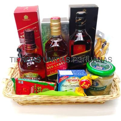 Canasta A�o Nuevo 5 - Codigo:ANN05 - Detalles: Canasta de mimbre, incluyendo: Tarjeta de dedicatoria, mo�o de regalo, sella para transporte. Contiene:  - 1 Whisky Black label - 1 Whisky Chivas regal - 1 Cabanossi - Aceitunas El Olivar - Alcachofas marinadas Don Alfonso. - 1 Whisky Red Label - 1 Select camenbert - Queso Brie Especial   - - Para mayores informes llamenos al Telf: 225-5120 o 980-660044.