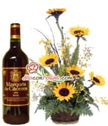 i-quiero.com - Arreglo de Girasoles con Vino importado - Codigo:OFE23 - Detalles: Arreglo Floral en base a 6 Girasoles junto a una botella de vino Resrva Importado Carolina de 750cc.  - - Para mayores informes llamenos al Telf: 225-5120 o 476-0753.