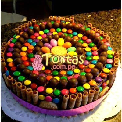 Tortas.com.pe - Torta Candy 07 - Codigo:TAA07 - Detalles: Espectacular torta a base de keke De Vainilla ba�ado con manjar . Contiene dulces segun imagen bastones dulces a los costados y caramelos surtidos en la parte superior. Tama�o de la torta: 25cm de diametro  - - Para mayores informes llamenos al Telf: 225-5120 o 476-0753.