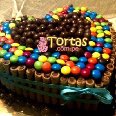 Tortas.com.pe - Torta Candy Corazon - Codigo:TAA08 - Detalles: Espectacular torta a base de keke De Vainilla ba�ado con manjar . Contiene dulces segun imagen bastones dulces a los costados y caramelos surtidos en la parte superior. Tama�o de la torta: 20cm de largo en forma de corazon  - - Para mayores informes llamenos al Telf: 225-5120 o 476-0753.