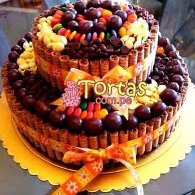 Tortas.com.pe - Torta Candy 14 - Codigo:TAA14 - Detalles: Espectacular torta a base de keke De Vainilla ba�ado con manjar . Contiene dulces segun imagen bastones dulces a los costados y caramelos surtidos en la parte superior. Tama�o de la torta: 25cm de diametro. 15 cm de diametro el segundo piso.  - - Para mayores informes llamenos al Telf: 225-5120 o 476-0753.