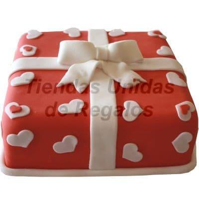 Torta Gran regalo - Codigo:WDA10 - Detalles: Delicioso queque De Vainilla   y decorado finamente con masa elastica en forma de cajita de regalo y corazones de 25 x 25. - - Para mayores informes llamenos al Telf: 225-5120 o 4760-753.