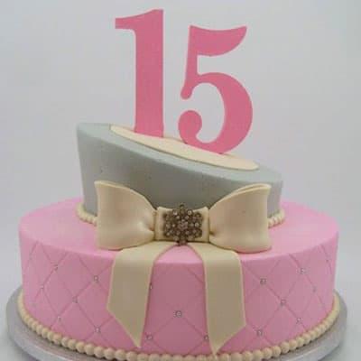 Torta quincea�era 34 - Codigo:WQC34 - Detalles: Deliciosa torta de keke De Vainilla   , ba�ada con manjar blanco y forrada con masa elastica con las siguientes medidas: 1er piso de 25cm de di�metro, 2do piso de 15cm de di�metro, lazo modelado con masa el�stica, incluye n�mero modelado con masa el�stica (no es vela) - - Para mayores informes llamenos al Telf: 225-5120 o 4760-753.