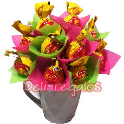 grameco.com - Linda taza de ceramica conteniendo arreglo especial de 10 deliciosos bonbon en arreglo segun imagen.  - Atendemos 24 horas. Llamar al 225-5120 o via Whatsapp: 980-660044